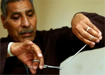 An Egyptian man demonstrates the FGM ritual